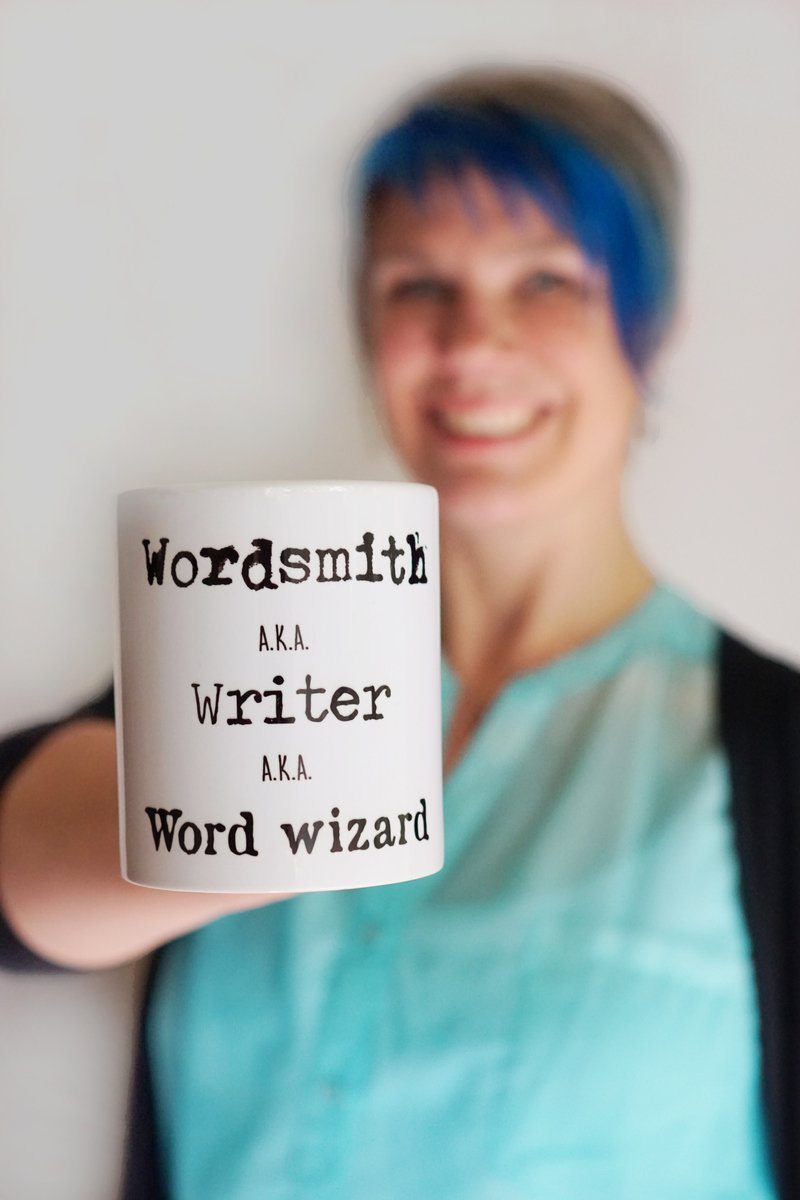 Andrea York holding copywriter coffee cup